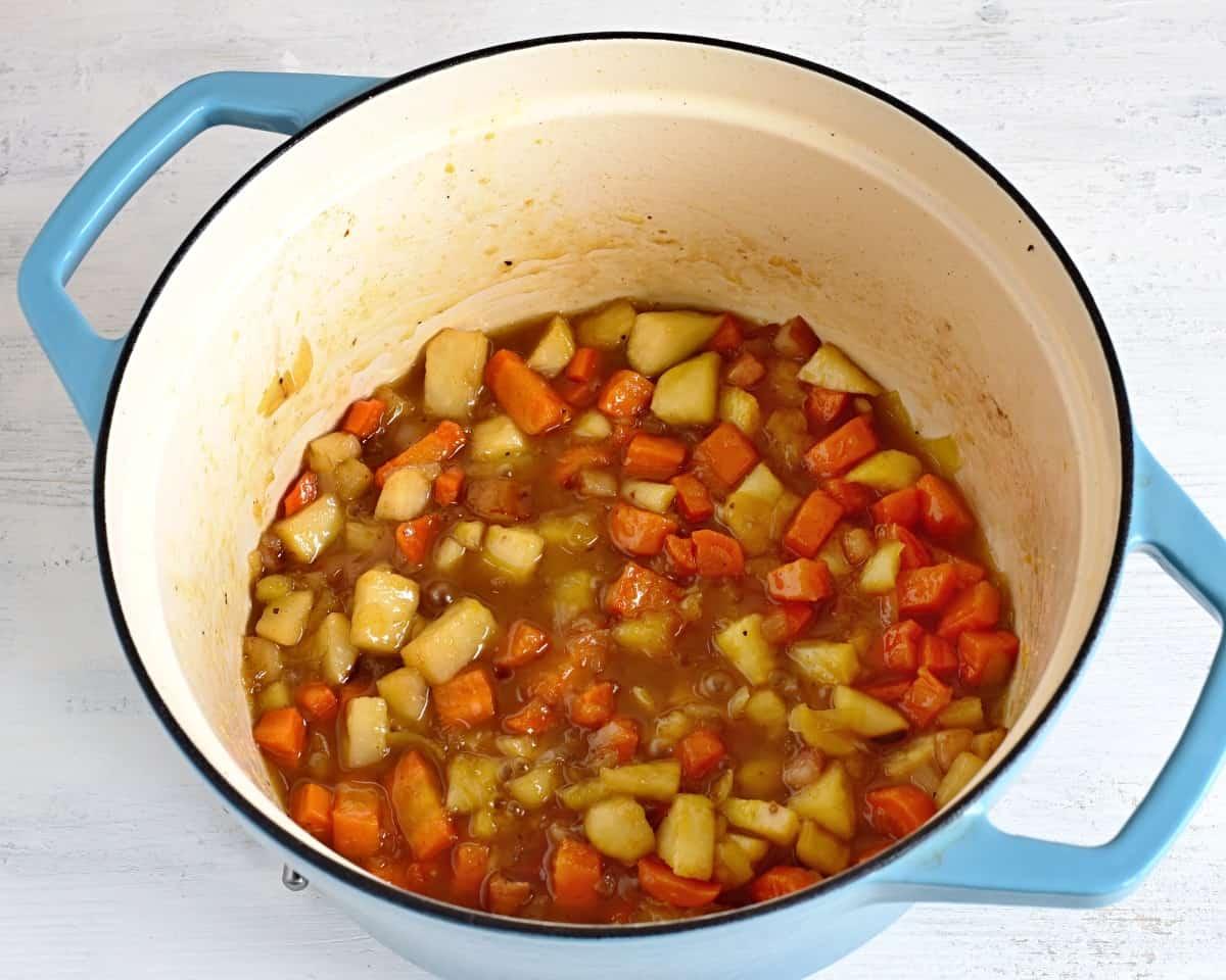 making svíčková sauteed vegetable in a pot