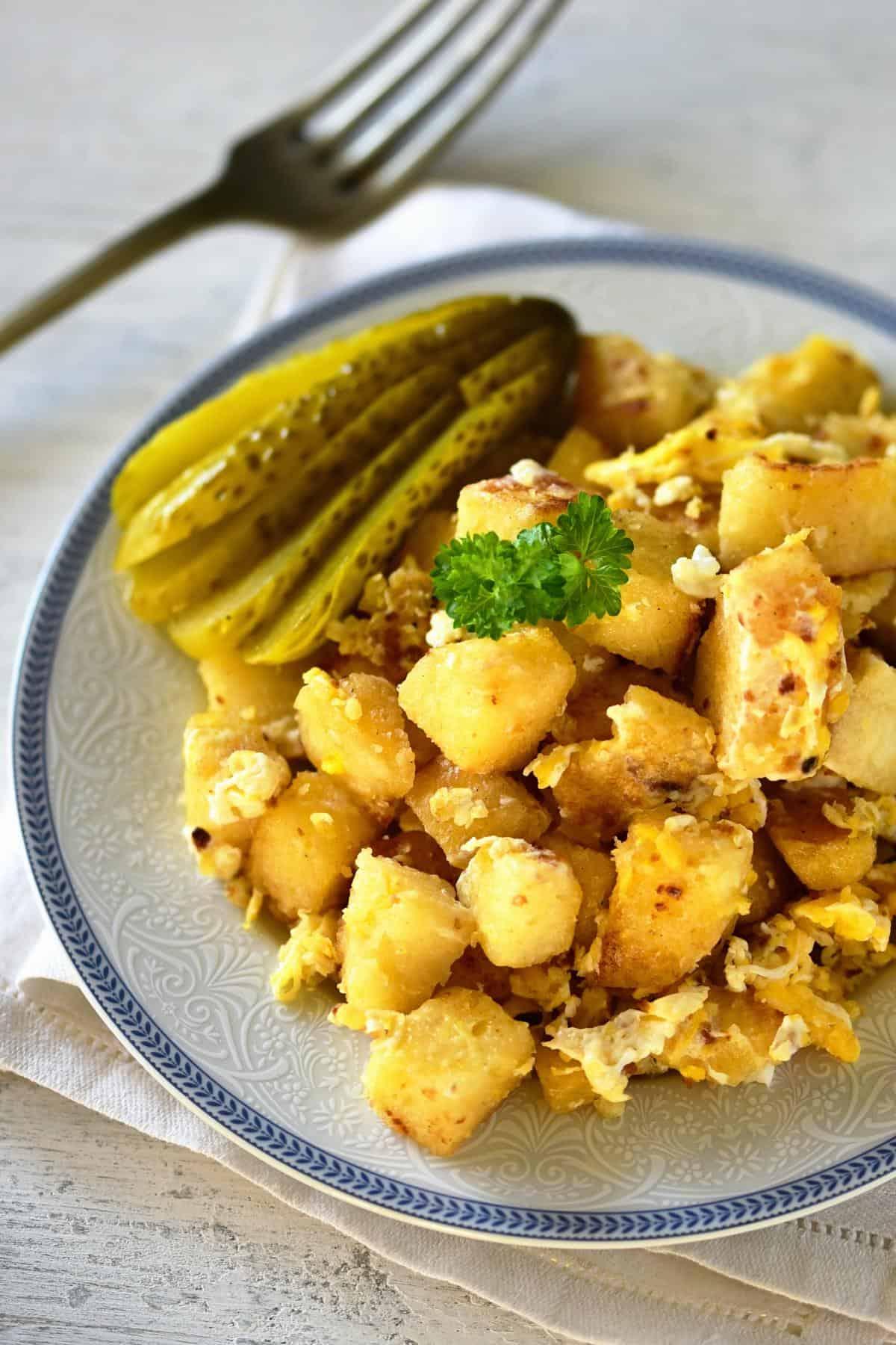 Knedlíky s vejci serving with picles