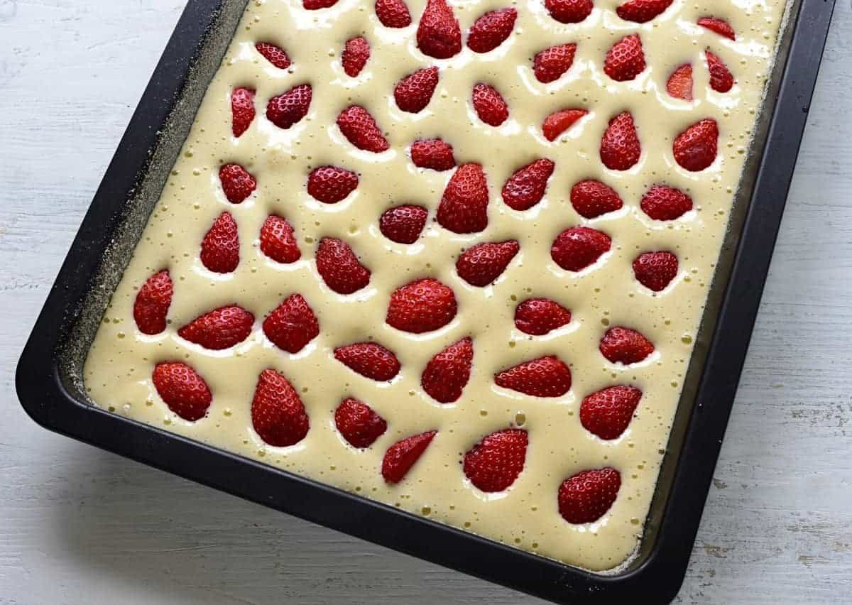 strawberry coffee cake in a baking sheet