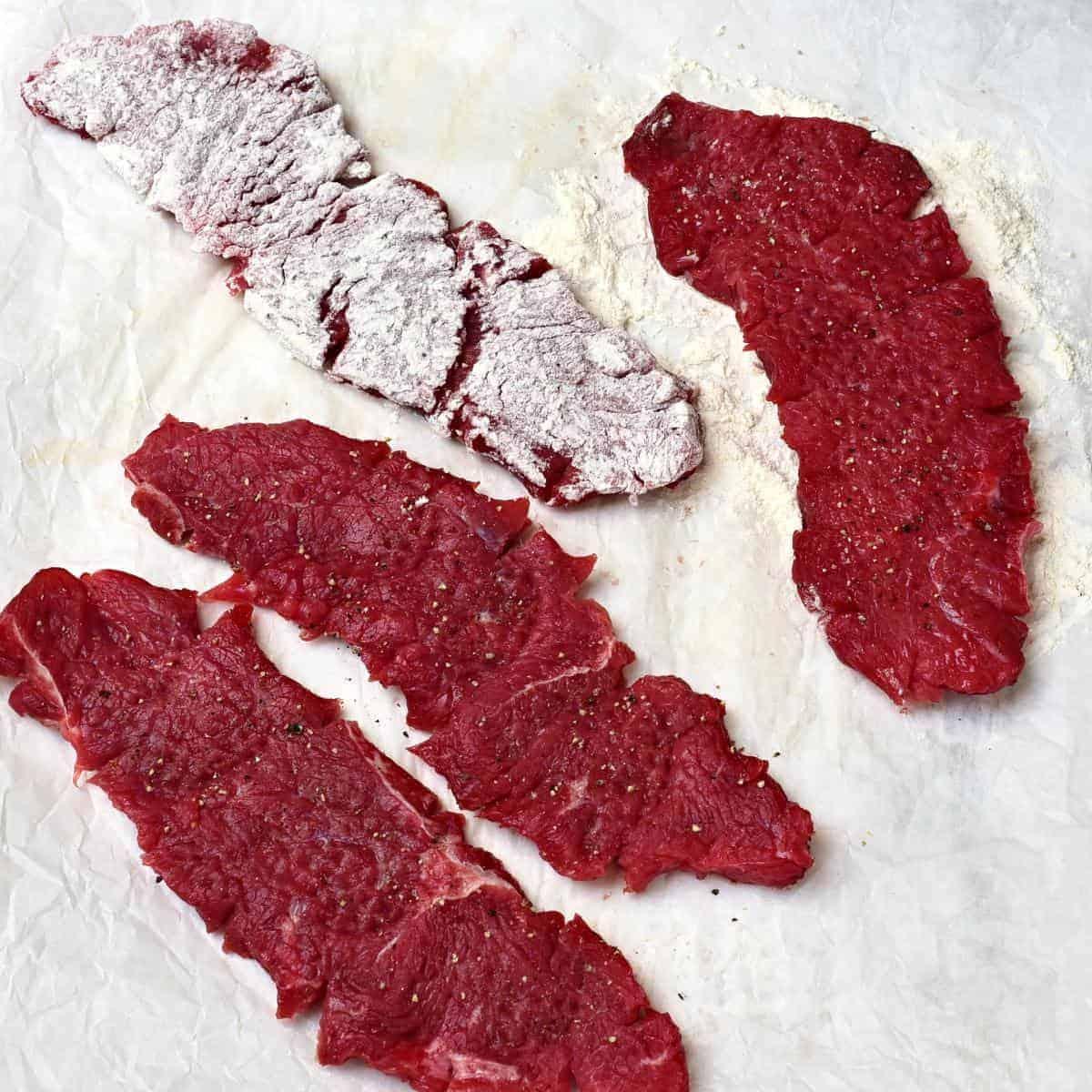 dreadging steaks in the flour