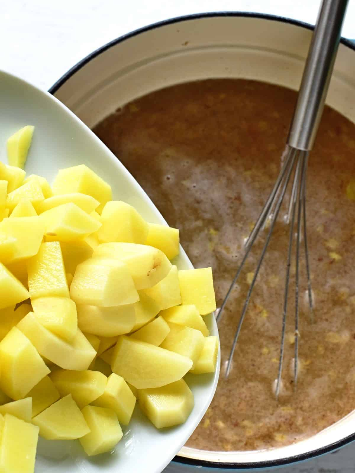 adding potatoes
