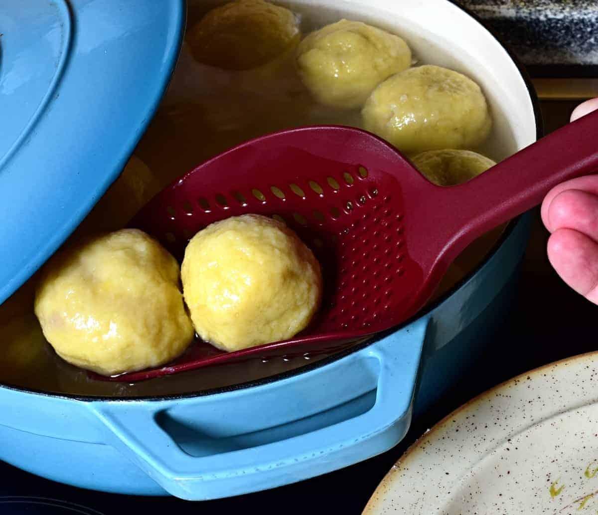 transfering cooked dumplings