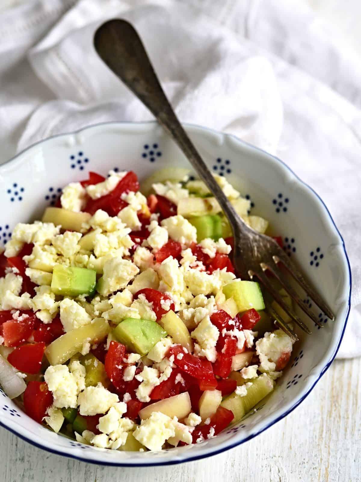 shopska salad served in a bowl