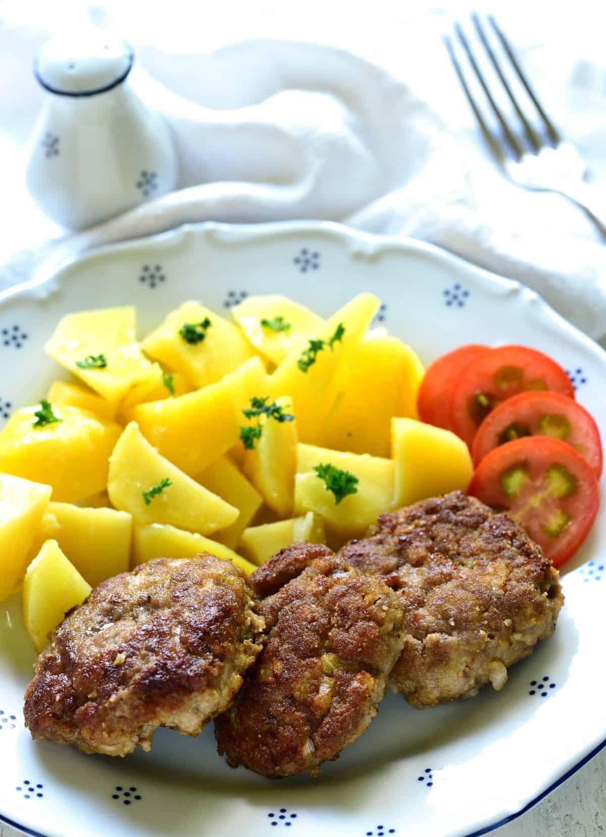 czech karabanek served with potatoes.