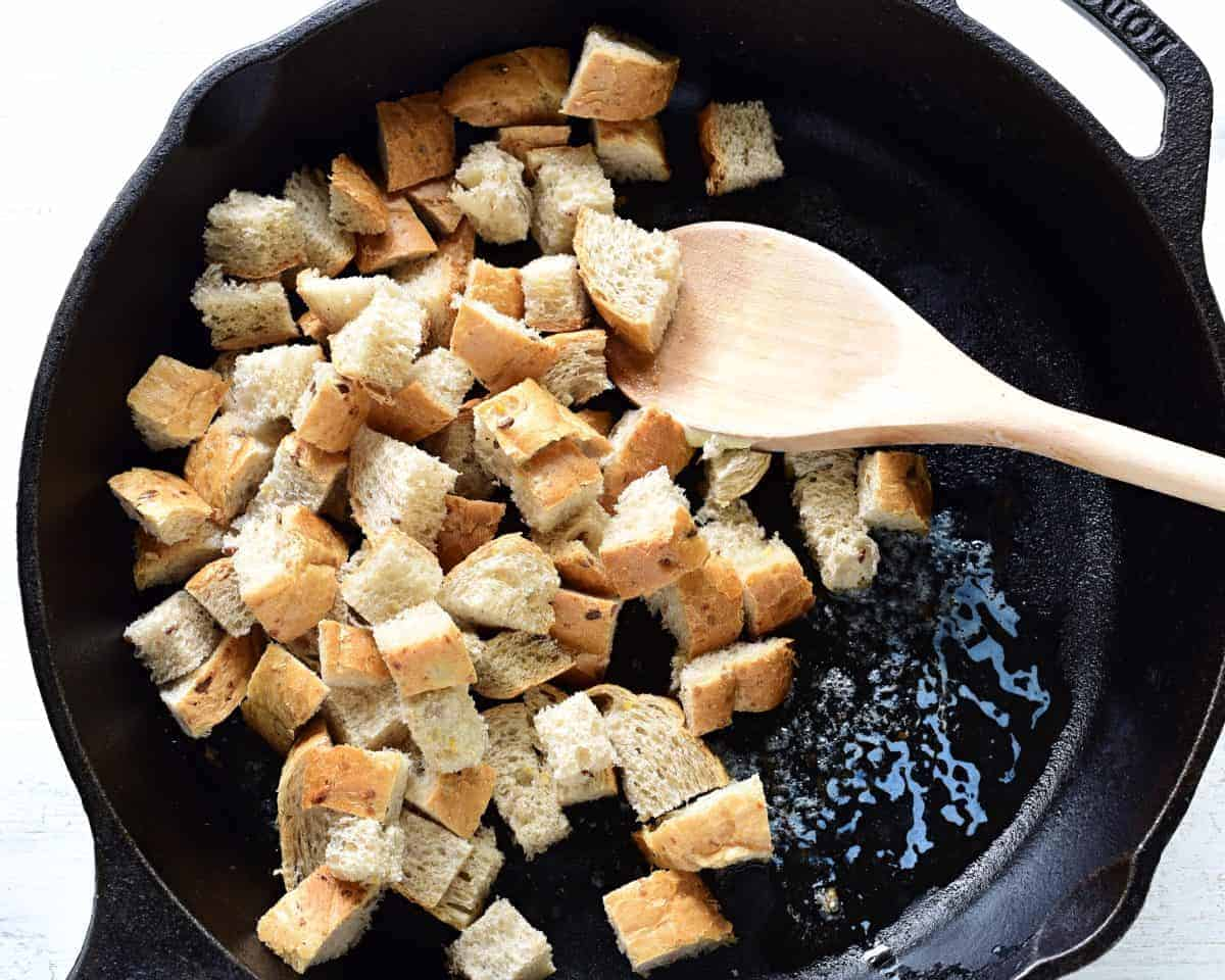 Making bread croutons in a pan.