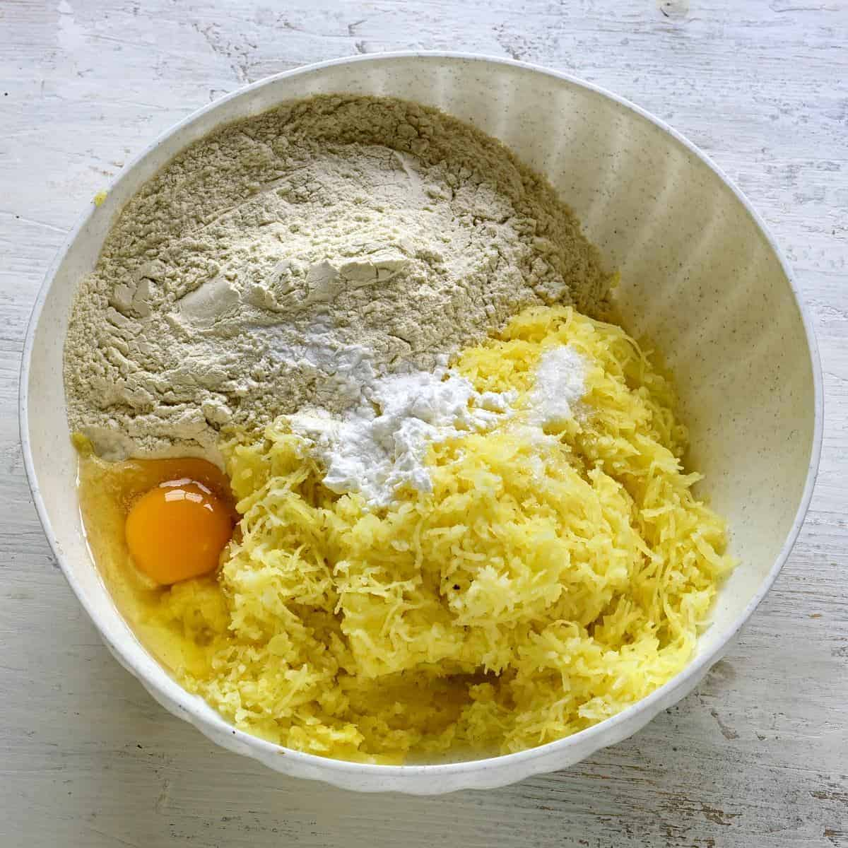 making potato dough for dumplings.