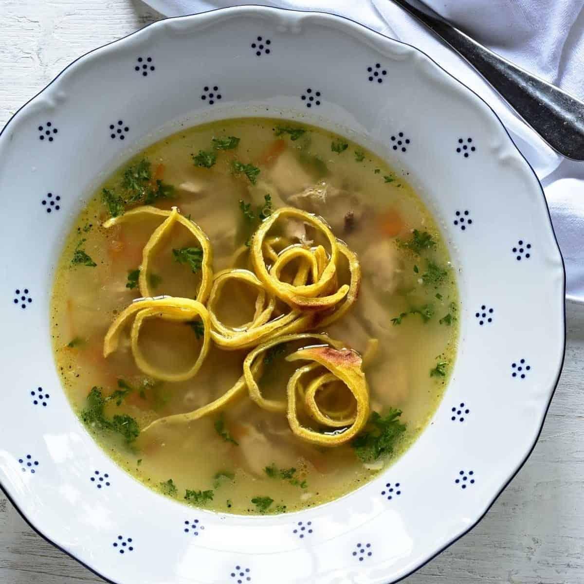 A clear soup served with celestýnské nudle (noodles).