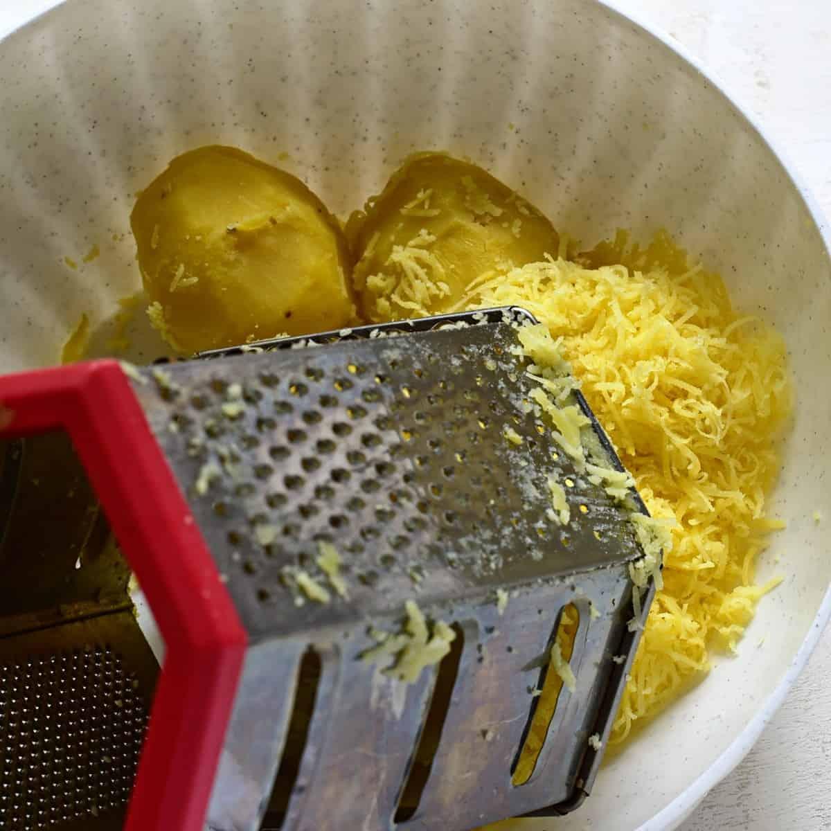 Grating potatoes.