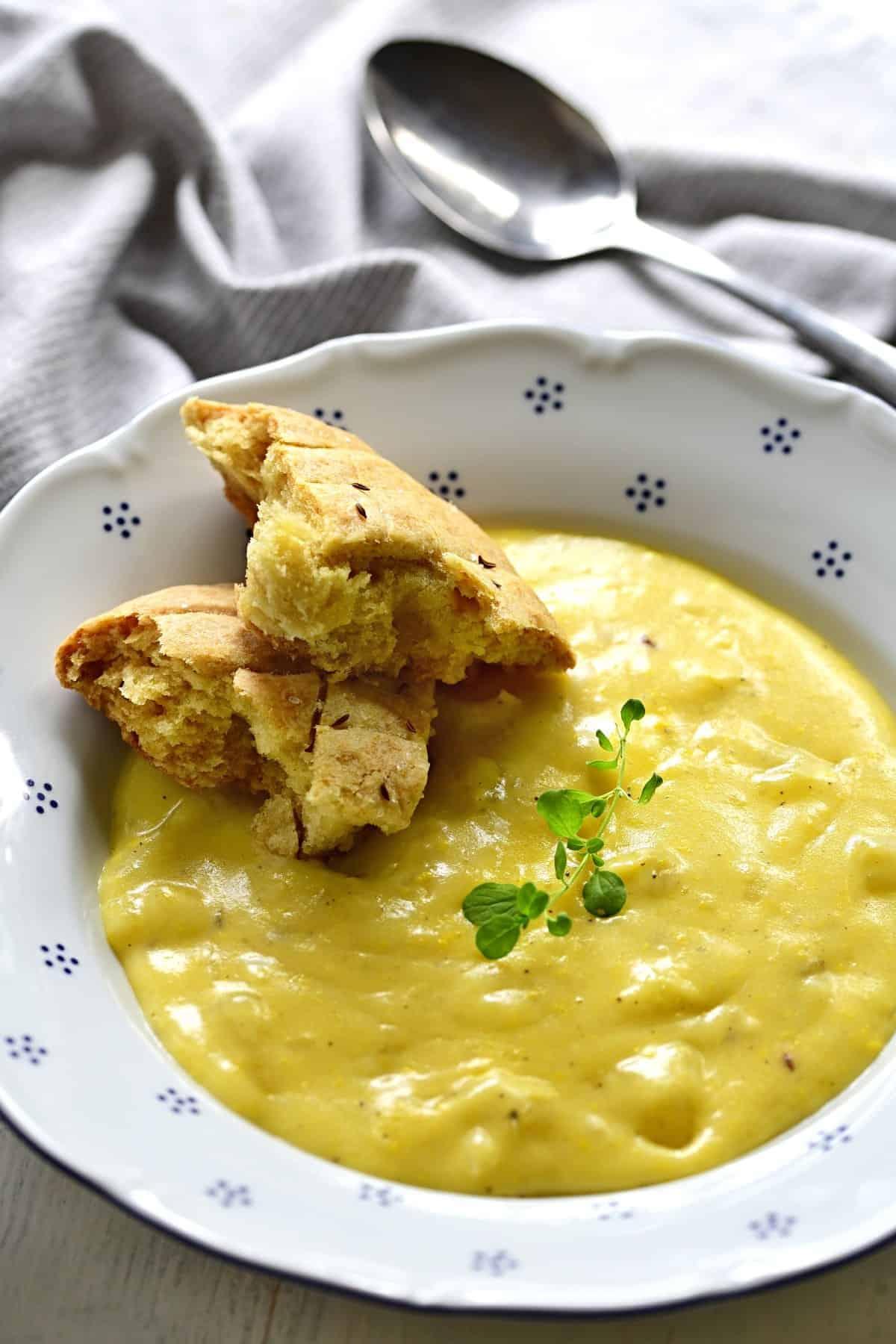 Krajanec served with potato sauce.