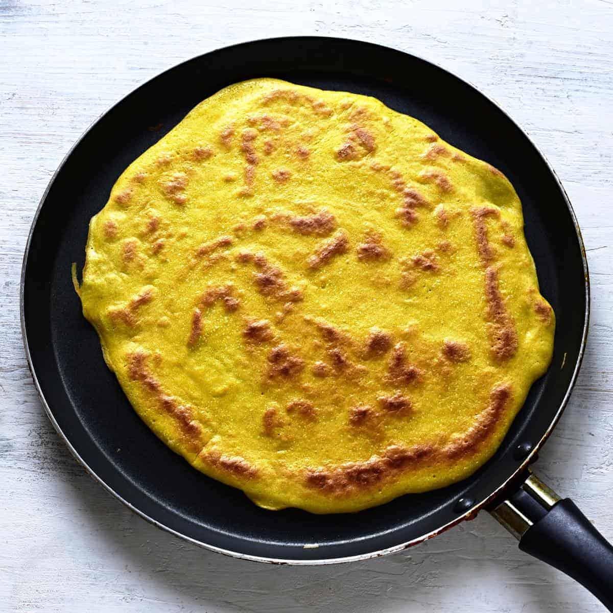 Frying pancake for celestýnské noodles.